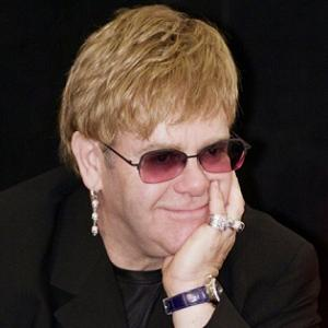 Elton John- Love Builds A Garden Lyrics
